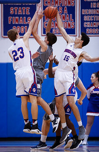 Gabriel Bergeron (15) from Dundee-Crown blocks a shot by Sam Carhart (2) from Cary-Grove during the third quarter of their game at Dundee-Crown on Friday, December 15, 2017 in Carpentersville, Illinois. The Chargers defeated the Trojans 70-51. John Konstantaras photo for Shaw Media