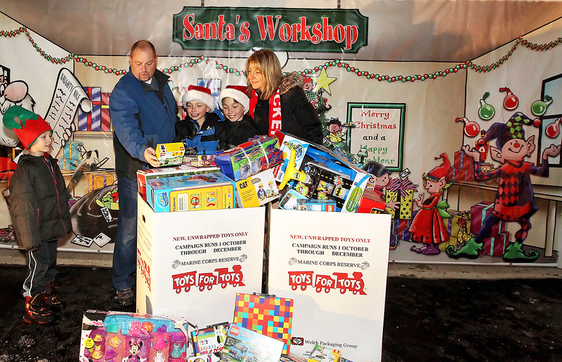 """Candace H. Johnson-For Shaw Media Tim and Cindy Herzog and their children, Peyton, 7, and twins John and Tyler, both 11, look at the toys people have dropped off for Toys For Tots at their """"Christmas House"""" in Round Lake.(12/15/17)"""