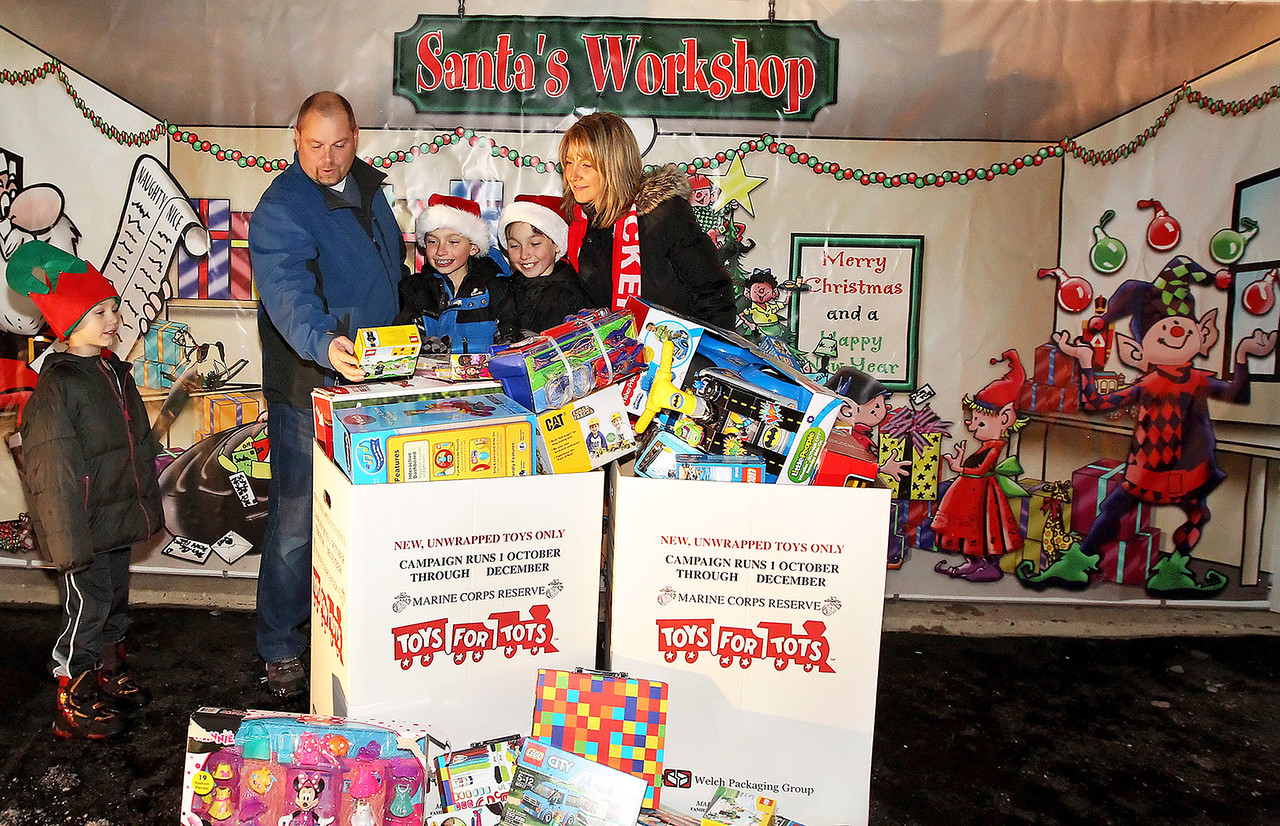 "Candace H. Johnson-For Shaw Media Tim and Cindy Herzog and their children, Peyton, 7, and twins John and Tyler, both 11, look at the toys people have dropped off for Toys For Tots at their ""Christmas House"" in Round Lake.(12/15/17)"