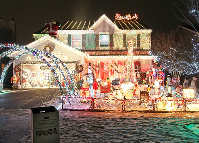 """Candace H. Johnson-For Shaw Media The Herzog """"Christmas House"""" has a Toys For Tots container in front of their home to collect toys for children in Round Lake.(12/15/17)"""