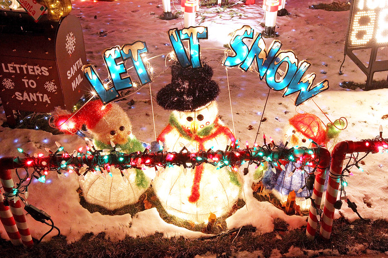 """Candace H. Johnson-For Shaw Media A group of snowmen light up the front yard of the Herzog """"Christmas House"""" in Round Lake.(12/15/17)"""