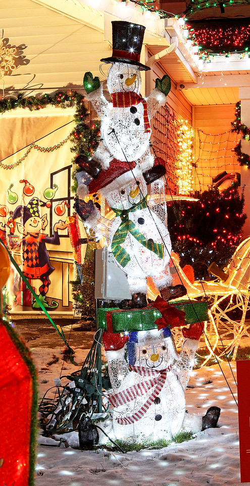 "Candace H. Johnson-For Shaw Media A stack of snowmen shine bright in the front yard of the Herzog ""Christmas House"" in Round Lake.(12/15/17)"