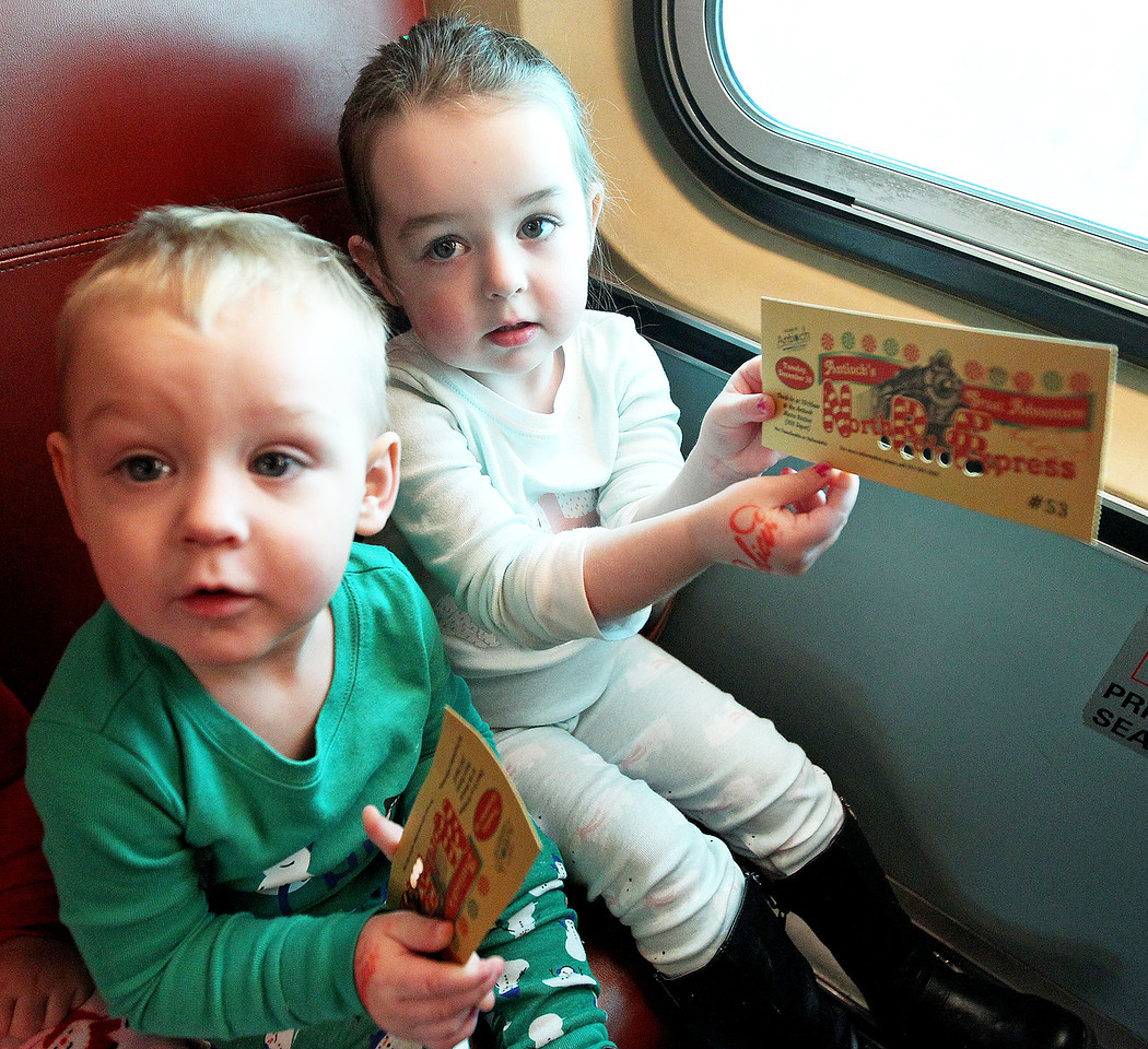 Candace H. Johnson-For Shaw Media Conor Rodriguez, 1, of Antioch and his sister, Adilynn, 3, show the golden tickets they used to get on the Metra train as they travel to the North Pole during Antioch's North Pole Express Train event.(12/19/17)