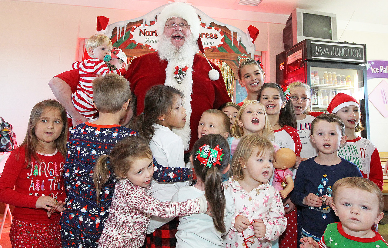 Candace H. Johnson-For Shaw Media Children gather around Santa to wish everyone a Merry Christmas at the North Pole during Antioch's North Pole Express Train event.(12/19/17)