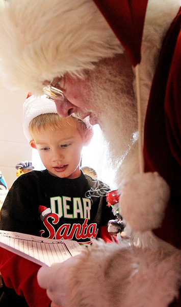 Candace H. Johnson-For Shaw Media Finn Stuebner, 4, of Lake Villa shows Santa his Christmas list at the North Pole during Antioch's North Pole Express Train event.(12/19/17)