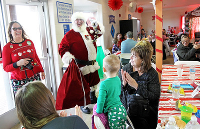 Candace H. Johnson-For Shaw Media Master Sergeant Elf Toni Galster, special events coordinator, stands close to Santa as he makes his way to the North Pole to greet children and their families during Antioch's North Pole Express Train event.Galster works for the Antioch's Parks & Recreation Department.(12/19/17)
