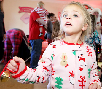 Candace H. Johnson-For Shaw Media Abigail Sheeks, 4, of Antioch rings her bell at the North Pole during Antioch's North Pole Express Train event .(12/19/17)