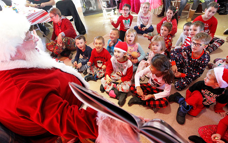 Candace H. Johnson-For Shaw Media Santa reads The Polar Express book to children at the North Pole during Antioch's North Pole Express Train event.(12/19/17)