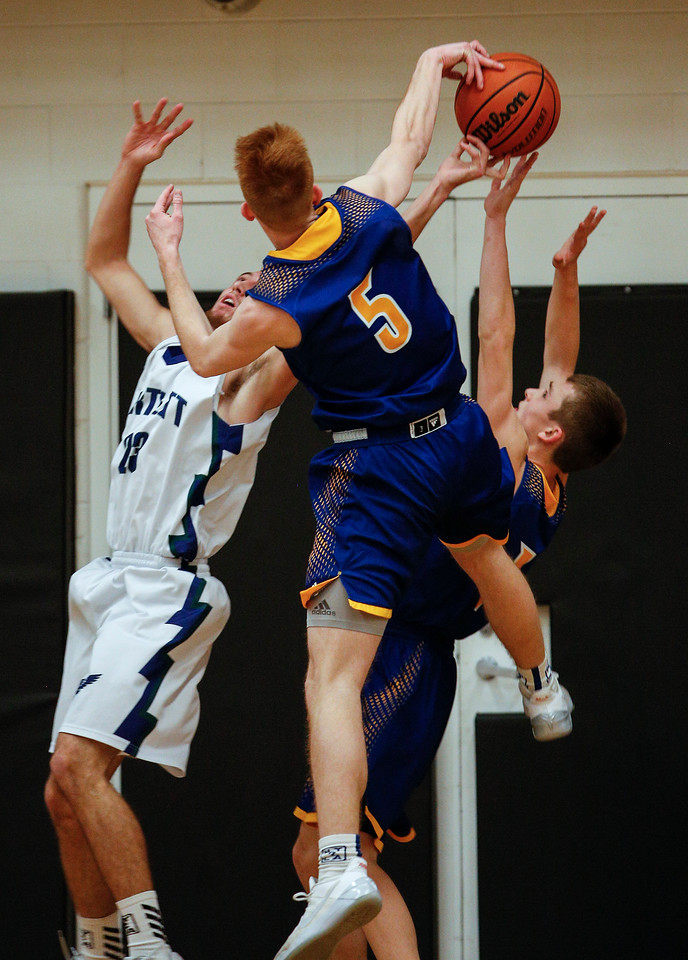 Jackson LaMarche (5) from Johnsburg blocks a shot by Austin Gates (23) from Bartlett during the first quarter of the Hinkle Holiday Classic at Jacobs High School on Friday, December 22, 2017 in Algonquin, Illinois. The Hawks defeated the Skyhawks 63-51. John Konstantaras photo for Shaw Media