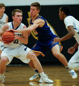 Brody Frazier (23) from Johnsburg tries to take the ball from Ben Fisher (32) from Bartlett during the third quarter of the Hinkle Holiday Classic at Jacobs High School on Friday, December 22, 2017 in Algonquin, Illinois. The Hawks defeated the Skyhawks 63-51. John Konstantaras photo for Shaw Media