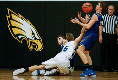 Jake Coffinbargar (5) from Bartlett loses the ball as Dylan Paprocki (right) and Alec Smith (11) from Johnsburg defend during the third quarter of the Hinkle Holiday Classic at Jacobs High School on Friday, December 22, 2017 in Algonquin, Illinois. The Hawks defeated the Skyhawks 63-51. John Konstantaras photo for Shaw Media