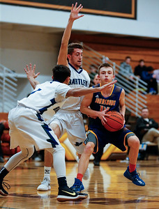 Zach Toussaint (14) from Johnsburg is guarded by Austin Gates (right) and Harsh Mangrola (1) from Bartlett during the first quarter of the Hinkle Holiday Classic at Jacobs High School on Friday, December 22, 2017 in Algonquin, Illinois. The Hawks defeated the Skyhawks 63-51. John Konstantaras photo for Shaw Media
