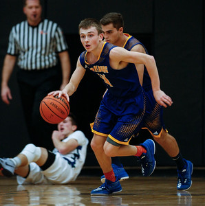 Zach Toussaint (14) from Johnsburg takes the ball cross court in the first quarter against Bartlett during the Hinkle Holiday Classic at Jacobs High School on Friday, December 22, 2017 in Algonquin, Illinois. The Hawks defeated the Skyhawks 63-51. John Konstantaras photo for Shaw Media