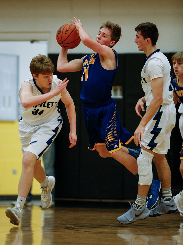 Alec Smith (11) from Johnsburg passes the ball over Nick Wolf (34) from Bartlett during the second quarter of the Hinkle Holiday Classic at Jacobs High School on Friday, December 22, 2017 in Algonquin, Illinois. The Hawks defeated the Skyhawks 63-51. John Konstantaras photo for Shaw Media