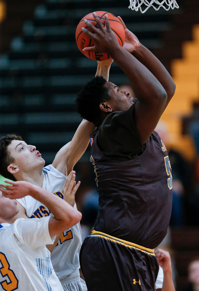 Joacheim Price (50) from Jacobs takes a shot during the fourth quarter of the Hinkle Holiday Classic at Jacobs High School on Saturday, December 23, 2017 in Algonquin, Illinois. The Golden Eagles defeated the Crusaders 71-31. John Konstantaras photo for Shaw Media