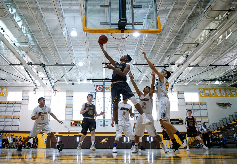 Kameron Mack (12) from Jacobs scores from the inside during the second quarter against Kennedy in the Hinkle Holiday Classic at Jacobs High School on Saturday, December 23, 2017 in Algonquin, Illinois. The Golden Eagles defeated the Crusaders 71-31. John Konstantaras photo for Shaw Media