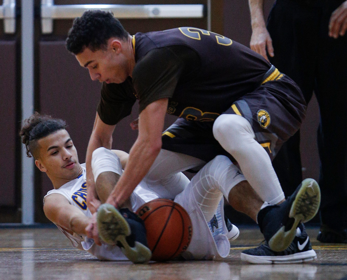 Nikolas Balkcom (33) from Jacobs reaches for a loose ball from Christopher Diaz (12) from Kennedy during the first quarter of the Hinkle Holiday Classic at Jacobs High School on Saturday, December 23, 2017 in Algonquin, Illinois. The Golden Eagles defeated the Crusaders 71-31. John Konstantaras photo for Shaw Media