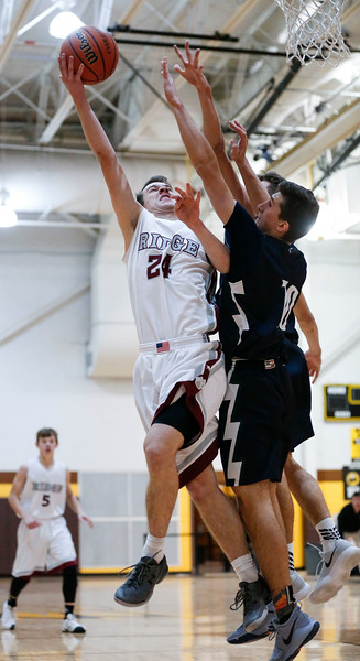 Daniel Sievers (10) from Prairie Ridge shoots on Tomas Vikonis (10) from Bartlett during the third quarter of the Hinkle Holiday Classic at Jacobs High School on Tuesday, December 26, 2017 in Algonquin, Illinois. The Hawks defeated the Wolves 53-42. John Konstantaras photo for Shaw Media