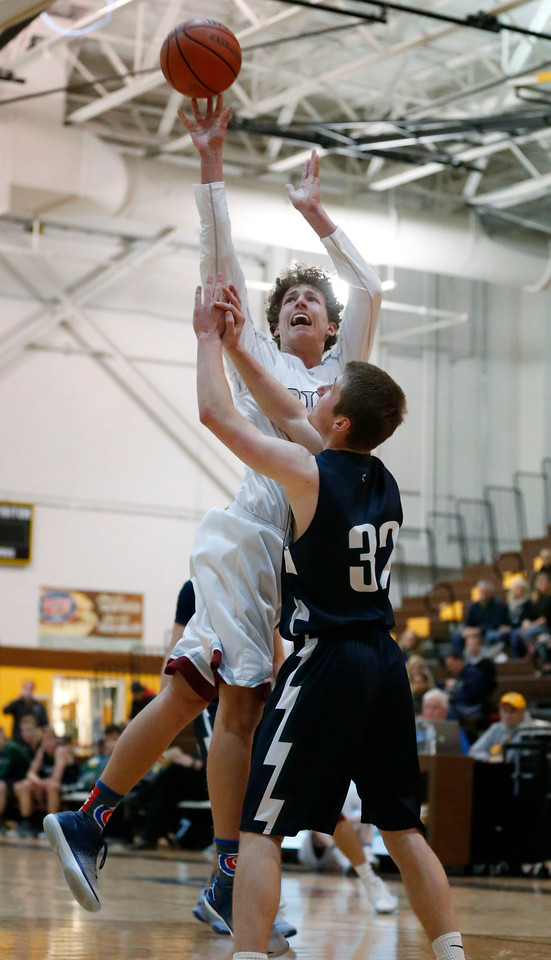 Drew Gende (32) from Prairie Ridge shoots over Ben Fisher (32) from Bartlett during the fourth quarter of the Hinkle Holiday Classic at Jacobs High School on Tuesday, December 26, 2017 in Algonquin, Illinois. The Hawks defeated the Wolves 53-42. John Konstantaras photo for Shaw Media