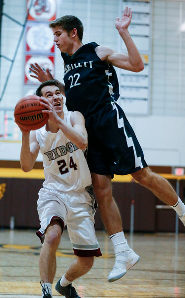 Garrett Jurina (22) from Bartlett defends Connor Kazin (24) from Prairie Ridge during the first quarter of the Hinkle Holiday Classic at Jacobs High School on Tuesday, December 26, 2017 in Algonquin, Illinois. The Hawks defeated the Wolves the game 53-42. John Konstantaras photo for Shaw Media
