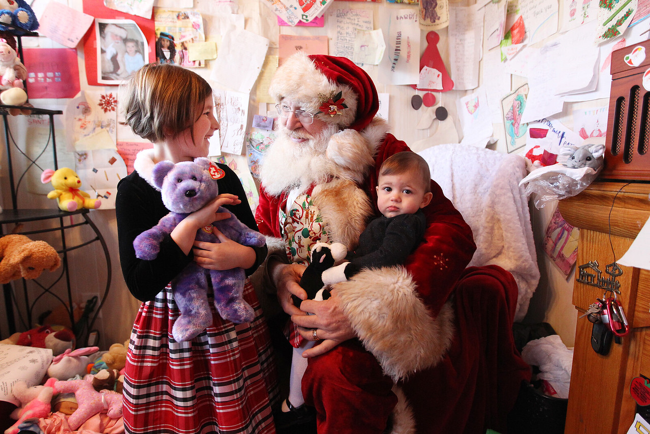 Candace H. Johnson-For Shaw Media Chloe Ronde, 6, of Spring Grove and her sister, Olivia, 1, visit with Santa at the Santa House in Millennium Park in Fox Lake. (12/23/17)