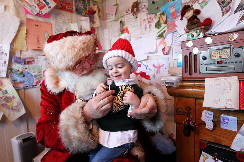 Candace H. Johnson-For Shaw Media Christian Morris, 2, of Grayslake gets a lollipop from Santa at the Santa House in Millennium Park in Fox Lake. Christian was at the Santa House with this parents, Collin and Erika, and brother, John, ten-weeks-old.(12/23/17)