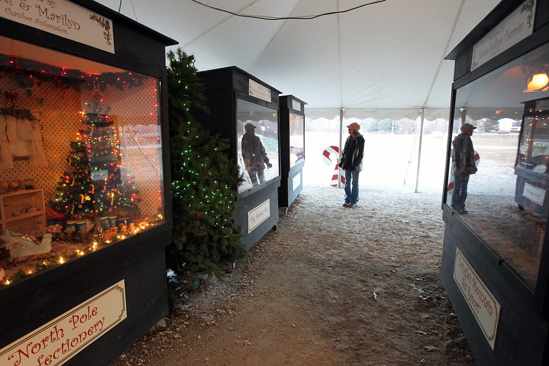 Candace H. Johnson-For Shaw Media Sue Lamagdeleine, of Antioch looks at the oversized shadow boxes in the Kringle's Christmas Village display in downtown Antioch. (12/23/17)
