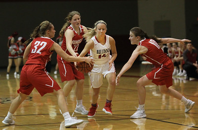 Candace H. Johnson-For Shaw Media Grant's Roxanne Temple (#14) drives to the basket against Mundelein's Kelsy Austwick, Hannah Buscher and Morgan Frank in the fourth quarter during the Holiday Tournament at Grant Community High School in Fox Lake. (12/26/17)