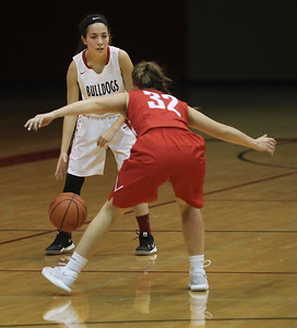 Candace H. Johnson-For Shaw Media Grant's Mercedes Uribe looks to drive around Mundelein's Kelsy Austwick in the second quarter during the Holiday Tournament at Grant Community High School in Fox Lake. Grant won 52-40.(12/26/17)