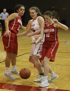 Candace H. Johnson-For Shaw Media Mundelein's Ellie Maldonado and Morgan Frank stop after fighting for a rebound with Grant's Mallory Harrity (center) as the ball goes out of bounds in the second quarter during the Holiday Tournament at Grant Community High School in Fox Lake. (12/26/17)