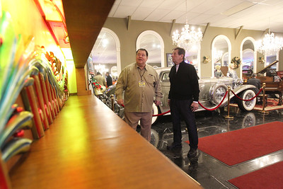 Candace H. Johnson-For Shaw Media Tim Trager, of McHenry, curator of the music machines, talks with Greg Grams, founder, next to a 92 key Mortier Dance Organ, a self-playing music machine, on display during the Grand Opening of the Duesenberg/Music Room at the Volo Auto Museum. (12/26/17)