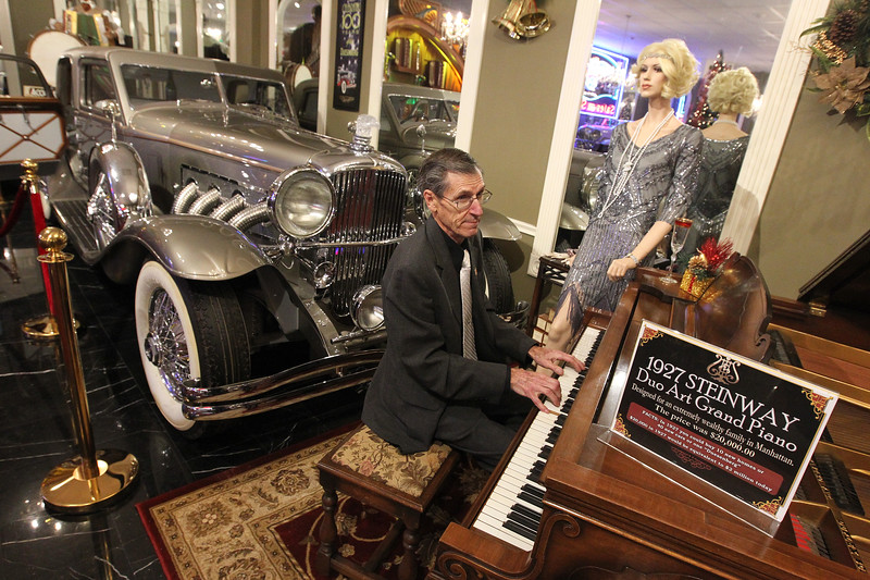 Candace H. Johnson-For Shaw Media Pianist Ron Vaughan, of Wauconda plays big band music on a 1927 Steinway Duo Art Grant Piano during the Grand Opening of the Duesenberg/Music Room at the Volo Auto Museum. Behind Vaughan was a 1933 Duesenberg on display.(12/26/17)