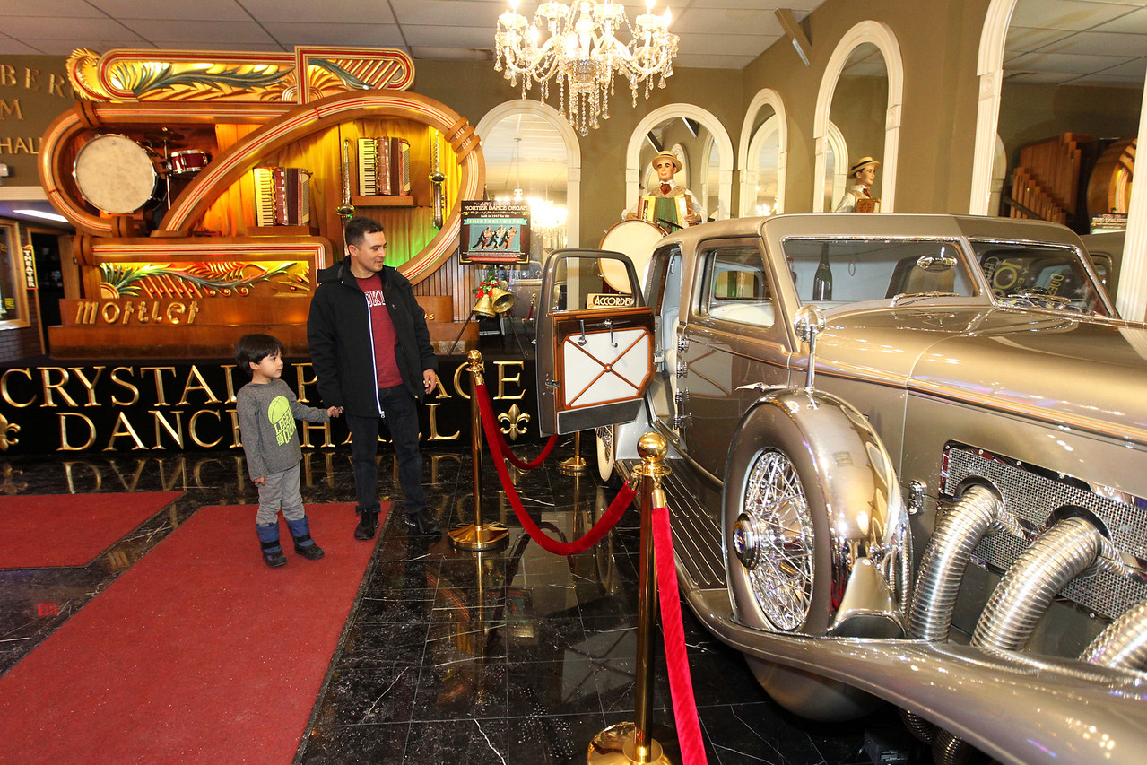 Candace H. Johnson-For Shaw Media Christian Carmen, 4, of Round Lake and his father, Leo, look at a 1933 Duesenberg during the Grand Opening of the Duesenberg/Music Room at the Volo Auto Museum. The car is over nineteen feet long. (12/26/17)