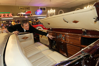 Candace H. Johnson-For Shaw Media Greg Grams, founder, points to the a second speedometer in the back seat of a 1932 Duesenberg convertible on display during the Grand Opening of the Duesenberg/Music Room at the Volo Auto Museum. (12/26/17)