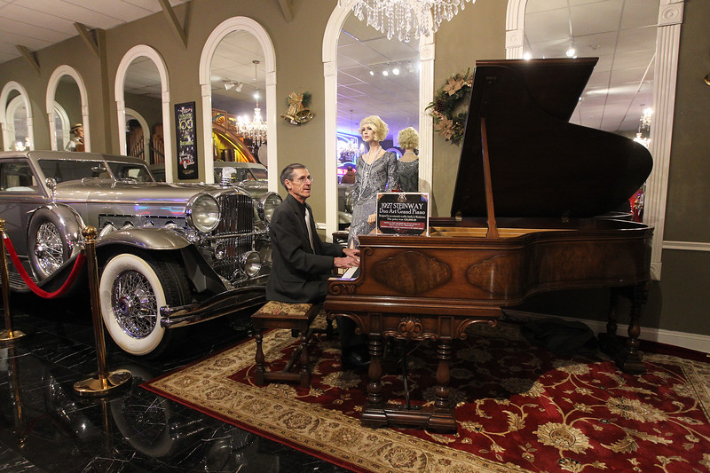 Candace H. Johnson-For Shaw Media Pianist Ron Vaughan, of Wauconda plays big band music on a 1927 Steinway Duo Art Grand Piano during the Grand Opening of the Duesenberg/Music Room at the Volo Auto Museum. (12/26/17)
