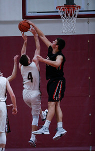 Alex Timmerman (55) from Crystal Lake Central blocks a shot by Alexander Schirmer (4) from Marengo during the first quarter of the championship game in the E.C. Nichols Holiday Classic at Marengo High School on Friday, December 29, 2017 in Marengo, Illinois. The Tigers defeated the Indians 72-57. John Konstantaras photo for Shaw Media