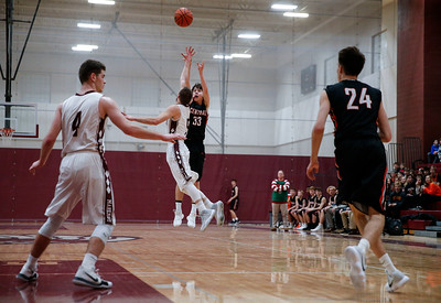 Christian Lerum (33) from Crystal Lake Central shoots over Blaine Borhart (5) from Marengo during the second quarter of the championship game in the E.C. Nichols Holiday Classic at Marengo High School on Friday, December 29, 2017 in Marengo, Illinois. The Tigers defeated the Indians 72-57. John Konstantaras photo for Shaw Media