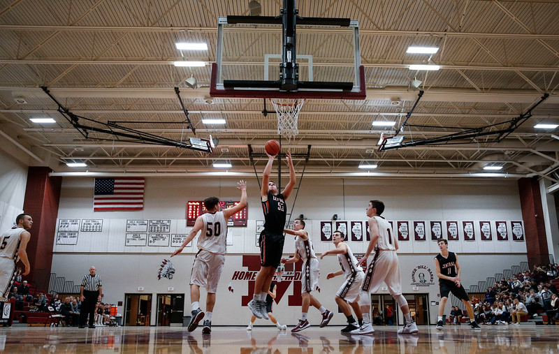 Alex Timmerman (55) from Crystal Lake Central scores a basket between Alejandro Rodriguez (50) and Nick Wascher (1) from Marengo during the third quarter of the championship game in the E.C. Nichols Holiday Classic at Marengo High School on Friday, December 29, 2017 in Marengo, Illinois. The Tigers defeated the Indians 72-57. John Konstantaras photo for Shaw Media