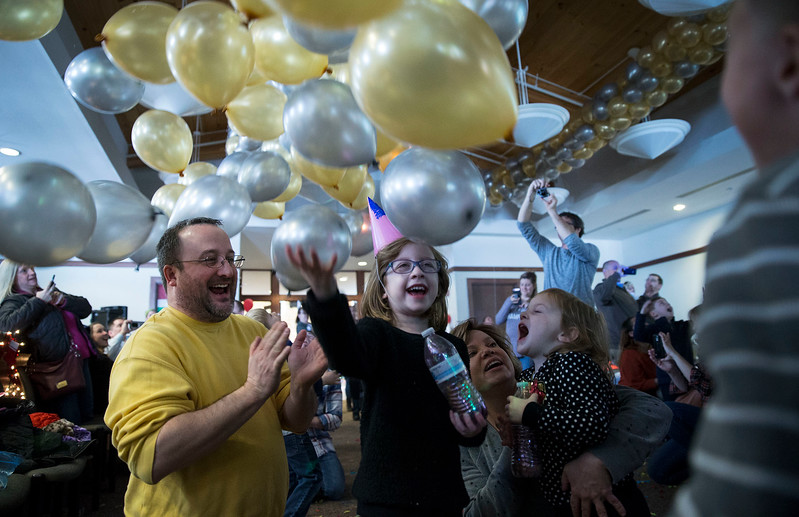 Josh Martin, from Lake in the Hills, celebrates the Noon Year's Eve balloon drop with his daughter Claire, 5, at Lake in the Hills Village Hall on Sunday, December 31, 2017 in Lake in the Hills, Illinois. John Konstantaras photo for Shaw Media