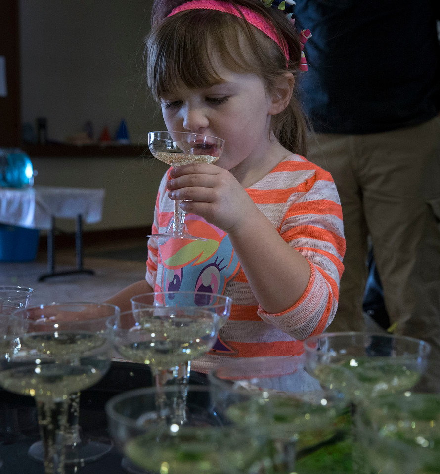 Olivia Jacobi, 4, has a sparkling juice after ringing in the Noon Year's Eve event at Lake in the Hills Village Hall on Sunday, December 31, 2017 in Lake in the Hills, Illinois. John Konstantaras photo for Shaw Media