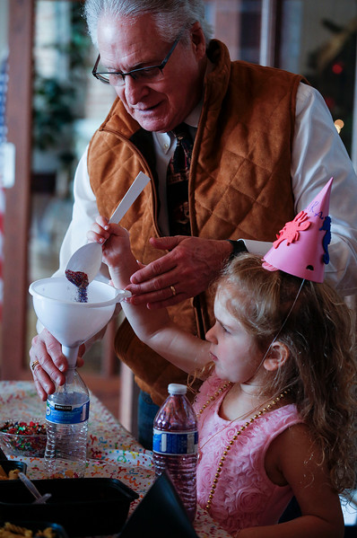 Keith Borcz, from Lake in the Hills, helps his grand daughter Mira, 4, put together a noise make for the Noon Year's Eve event at Lake in the Hills Village Hall on Sunday, December 31, 2017 in Lake in the Hills, Illinois. John Konstantaras photo for Shaw Media