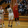 Batavia's Paris Chaney puts the shot up over Streamwood's Mandy Mien on Dec. 7 in Streamwood.