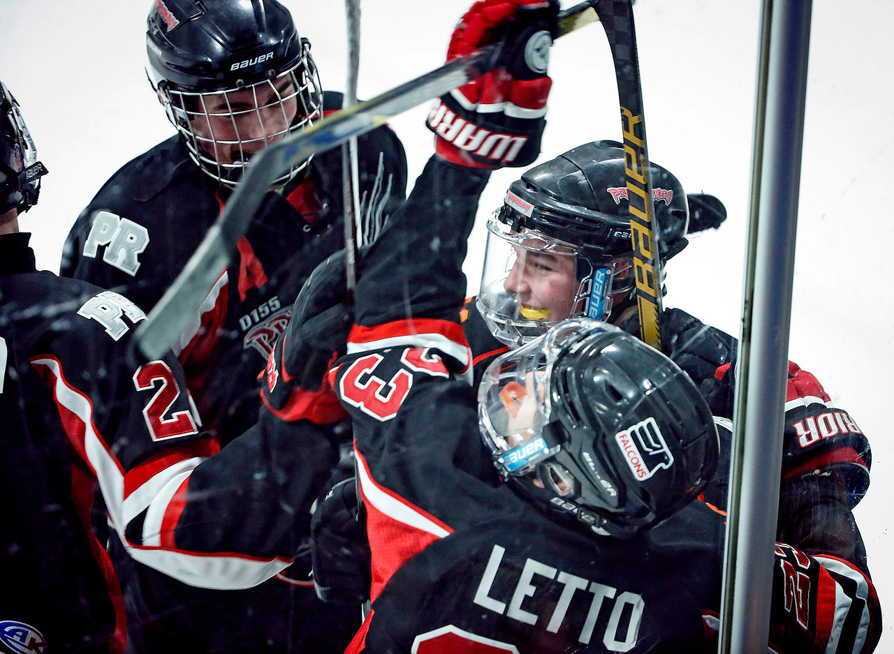 Brennan Kelly (14, right) from D155 celebrates his goal with his teammates during the first period of their game against Crystal Lake South at the Leafs Ice Center on Sunday, December 10, 2017 in West Dundee, Illinois. The game ended in a 3-3 tie. John Konstantaras photo for Shaw Media