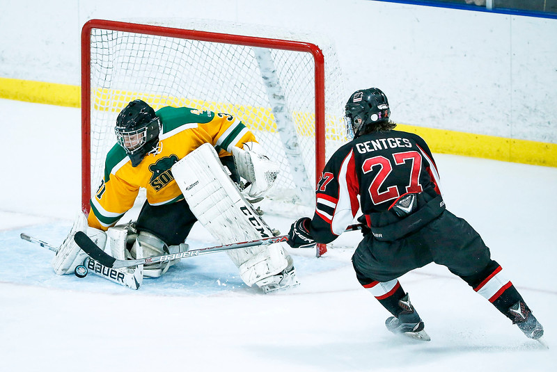 Garrett Braden (31) from Crystal Lake South makes a save on a shot by Sam Gentles (27) from D155 during the third period of their game at the Leafs Ice Center on Sunday, December 10, 2017 in West Dundee, Illinois. The game ended in a 3-3 tie. John Konstantaras photo for Shaw Media