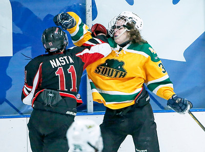 Patrick Nasta (11) from D155 and Augustus Johnson (34) from Crystal Lake South exchange blows during the third period of their game at the Leafs Ice Center on Sunday, December 10, 2017 in West Dundee, Illinois. The game ended in a 3-3 tie. John Konstantaras photo for Shaw Media