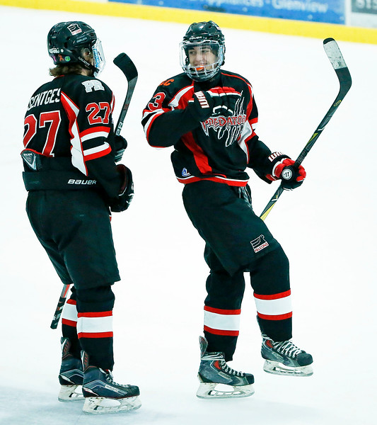 Ben Letto (23, right) celebrates his goal with Sam Gentles (27) from D155 during the second period of their game against Crystal Lake South at the Leafs Ice Center on Sunday, December 10, 2017 in West Dundee, Illinois. The game ended in a 3-3 tie. John Konstantaras photo for Shaw Media