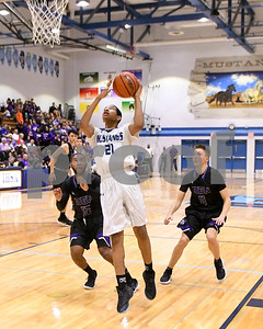 Downers Grove South's Justin Eagins (21) goes up for a shot during the game against Downers Grove North Dec. 16 at Downers Grove South High School. David Toney - For Shaw Media