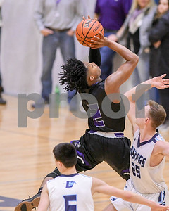 Downers Grove North's Semaj Henderson (02) goes up for a shot and gets fouled during their game against Downers Grove South Dec. 16 at Downers Grove South High School. David Toney - For Shaw Media