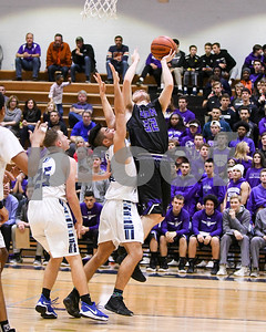 Downers Grove North's Ryan Force goes up for a shot in the third quarter during their game against Downers Grove South Dec. 16 at Downers Grove South High School. David Toney - For Shaw Media