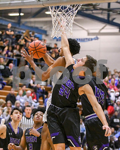 Downers Grove North Drew Cassens (24) tries to defend Downers Grove South player in the first quarter Saturday in the first quarter.